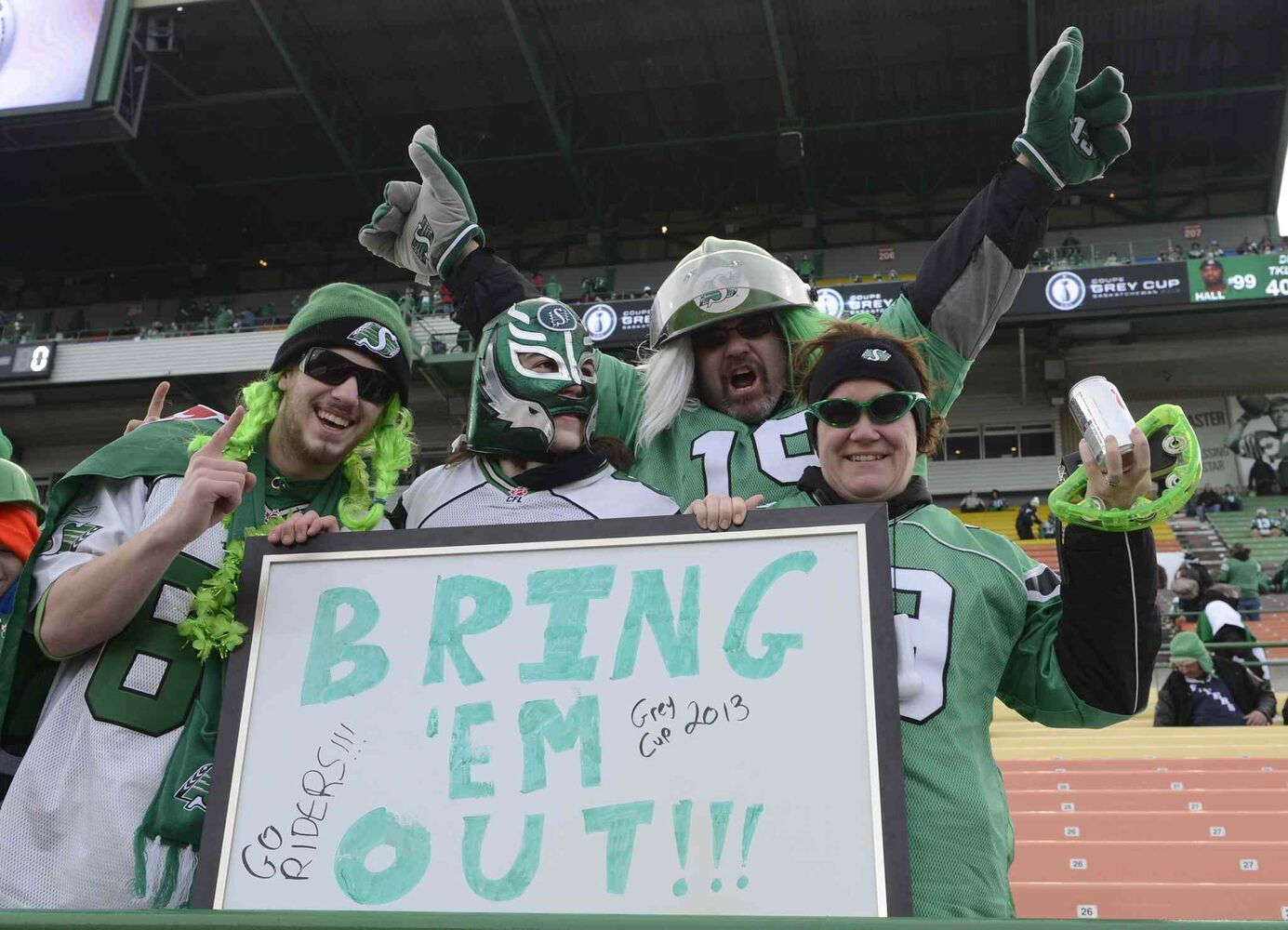 Saskatchewan Roughriders fans ham it up at the Grey Cup Saturday November 24, 2013 in Regina. (Ryan Remiorz / The Canadian Press)