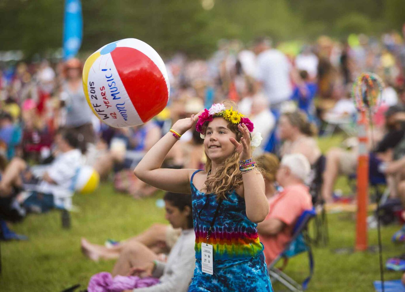 Chiara Kivilaht, 10, tosses a beach ball through the crowd at the Winnipeg Folk Festival at Birds Hill Provincial Park on Saturday, July 11, 2015.   Mikaela MacKenzie / Winnipeg Free Press (Winnipeg Free Press)