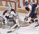 Winnipeg Jets captain Dale Hawerchuk tries to score on Edmonton Oilers goalie Bill Ranford during NHL playoff action in Edmonton, April 4, 1990. Jet diehards kept the spirit of the team alive on websites and chatrooms, lobbying for a team and keeping track of Jets alumni like Bobby Hull, Thomas Steen and Hawerchuk.THE CANADIAN PRESS/Ray Giguere