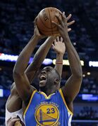 Golden State Warriors forward Draymond Green (23) goes to the basket against New Orleans Pelicans guard Quincy Pondexter during the first half of Game 4 of a first-round NBA basketball playoff series in New Orleans, Saturday, April 25, 2015. (AP Photo/Gerald Herbert)