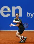 Britain's Andy Murray returns the ball to Roberto Bautista from Spain during the semifinal match at the BMW Open tennis tournament in Munich, Germany, on Saturday, May 2, 2015. (AP Photo/Matthias Schrader)