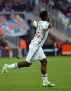 Marseille's Belgian forward Michy Batshuayi, celebrates after scoring against Marseille, during the League One soccer match between Marseille and Lille, at the Velodrome Stadium, in Marseille, southern France, Sunday, Dec. 21, 2014. (AP Photo/Claude Paris)