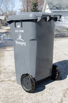 Winnipeg's city council approved the free replacement of damaged garbage and recycling bins.