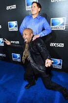 Mark Cuban, back, and Daymond John arrive at the 2015 DIRECTV Super Saturday Night party at the Pendergast Family Farm on Saturday, Jan. 31, 2015 in Glendale, Ariz. (Photo by Scott Roth/Invision/AP)