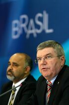 International Olympic Committee President Thomas Bach, right, speaks during a news conference accompanied by Brazil's Sport Minister George Hilton at the Planalto presidential palace in Brasilia, Brazil, Tuesday, Feb. 24, 2015. The IOC's coordination commission is visiting venues and meeting with local organizers as Rio races to be ready on time for South America's first games, set for 2016. (AP Photo/Eraldo Peres)
