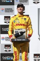 Ryan Hunter-Reay holds his trophy following his third place finish at the GoPro Grand Prix of Sonoma IndyCar series auto race, Sunday, Aug. 24, 2014, in Sonoma, Calif. (AP Photo/Elijah Nouvelage)