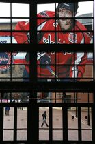 A large photo of Washington Capitals captain and All-Star Alex Ovechkin adorns the windows above and entrance to the Nationwide Arena for the NHL All-Star hockey weekend in Columbus, Ohio, Friday, Jan. 23, 2015. (AP Photo/Gene J. Puskar