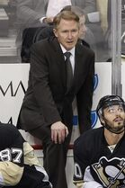 Pittsburgh Penguins' Mike Johnston stands behind his bench during the third period of a first-round NHL playoff hockey game against the New York Rangers in Pittsburgh on Wednesday, April 22, 2015. The Rangers won 2-1 and took a 3-1 lead in the series. (AP Photo/Gene J. Puskar)
