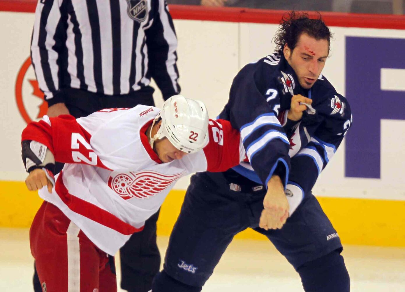 Detroit Red Wings forward Jordan Tootoo opens a gash on Winnipeg Jets forward Chris Thorburn during a first-period scrap.