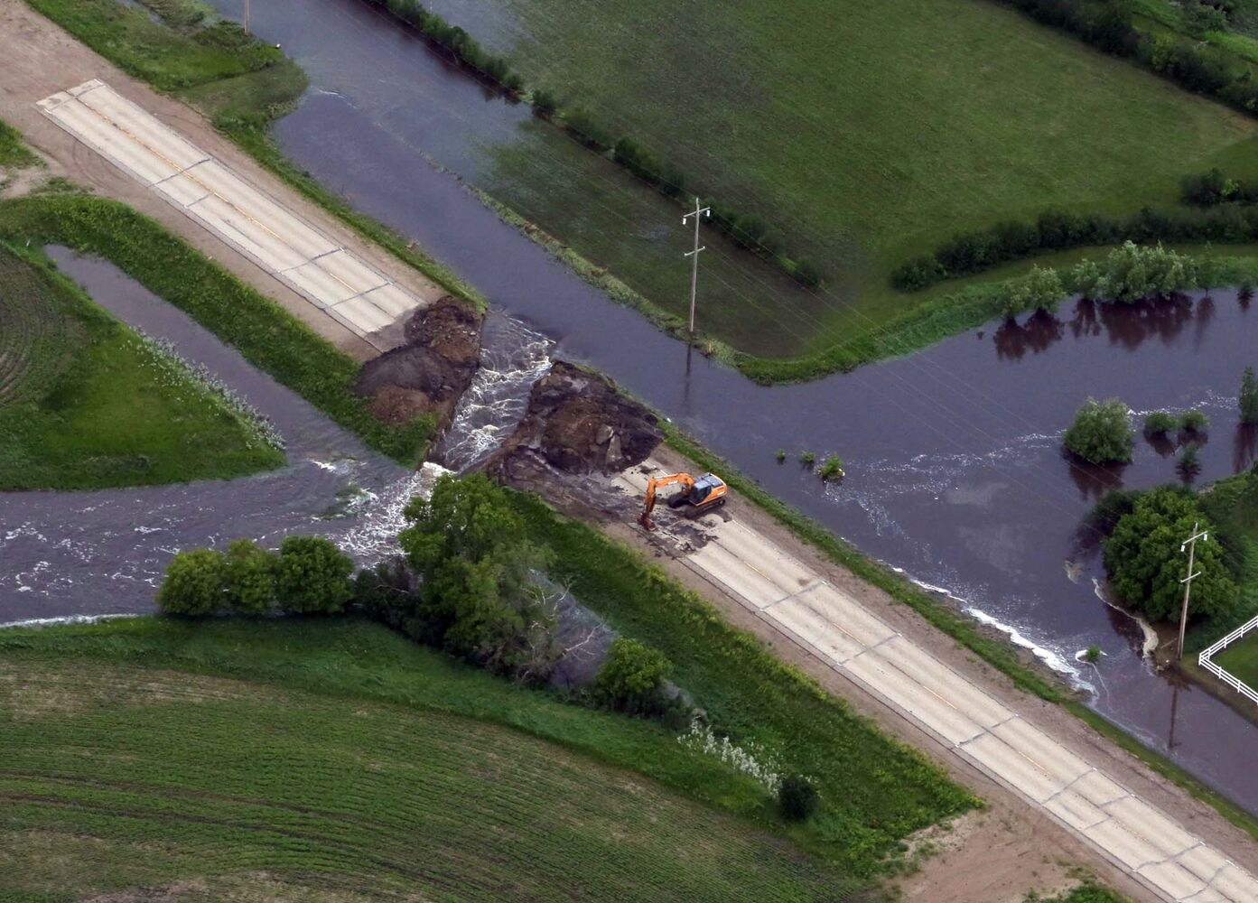 Damage to Veterans Way is seen after heavy weekend rainfall left a swath of flooding across southwestern Manitoba. Over 100 mm of rain fell in the area, with 127 mm recorded at Brandon Airport.