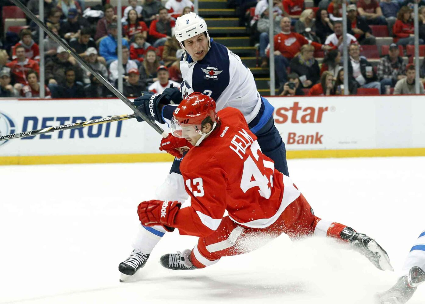 Winnipeg Jets defenceman Adam Pardy levels Detroit Red Wings forward Darren Helm during the second period.