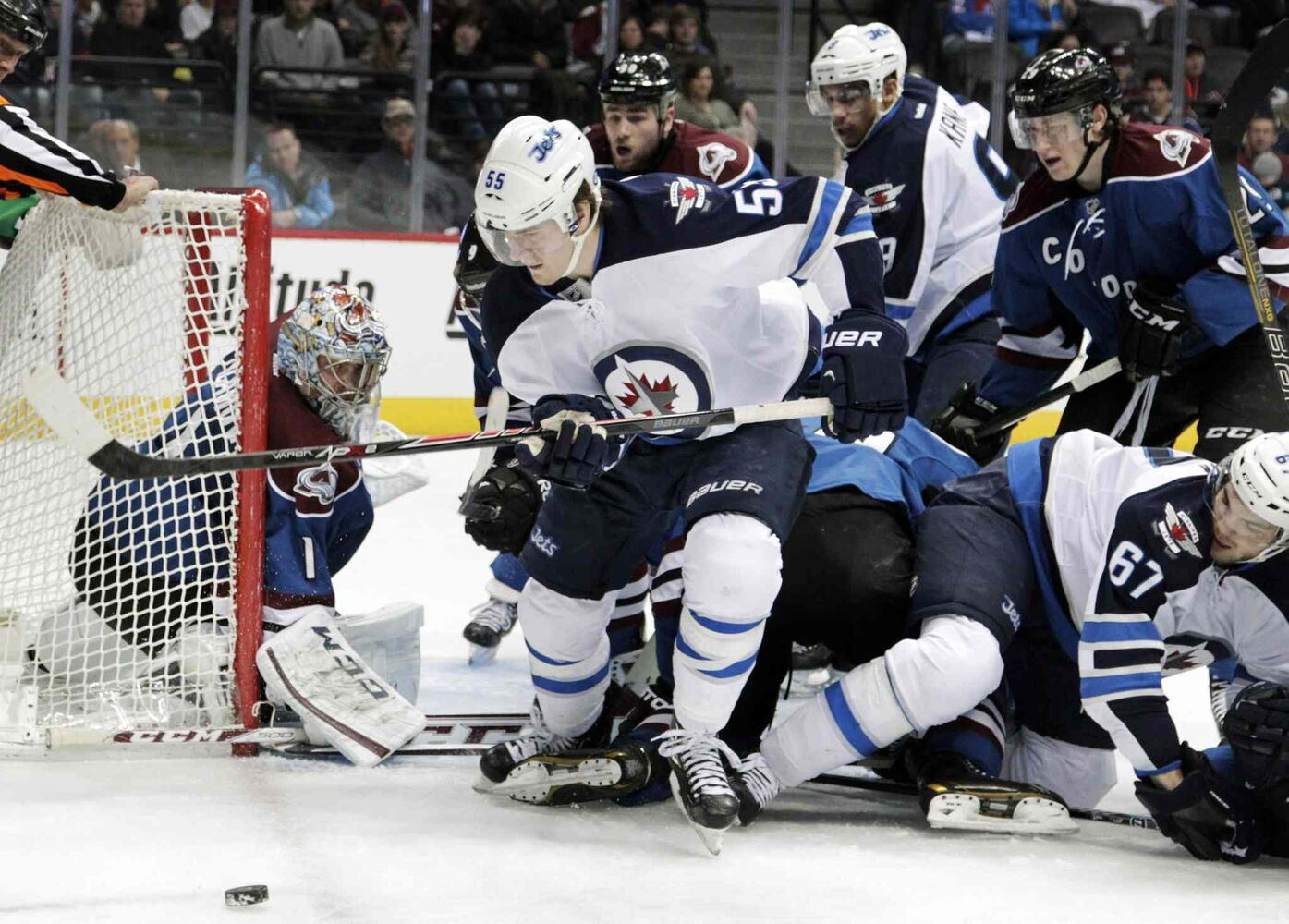 Winnipeg Jets center Mark Scheifele (front) chases the puck behind the net during the second period.