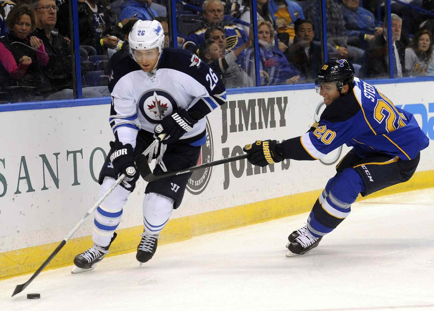 Winnipeg Jets' Blake Wheeler skates by St. Louis Blues' Alexander Steen (20) during the first period. (CP)