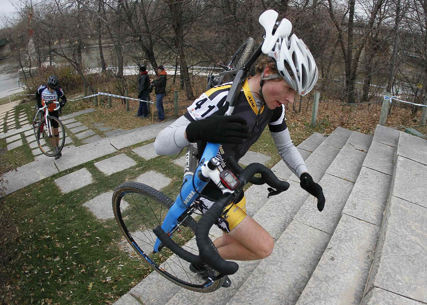 Race leader (and eventual winner) Chris Prendergrast (41) climbs a set of stairs. (John Woods / Winnipeg Free Press)
