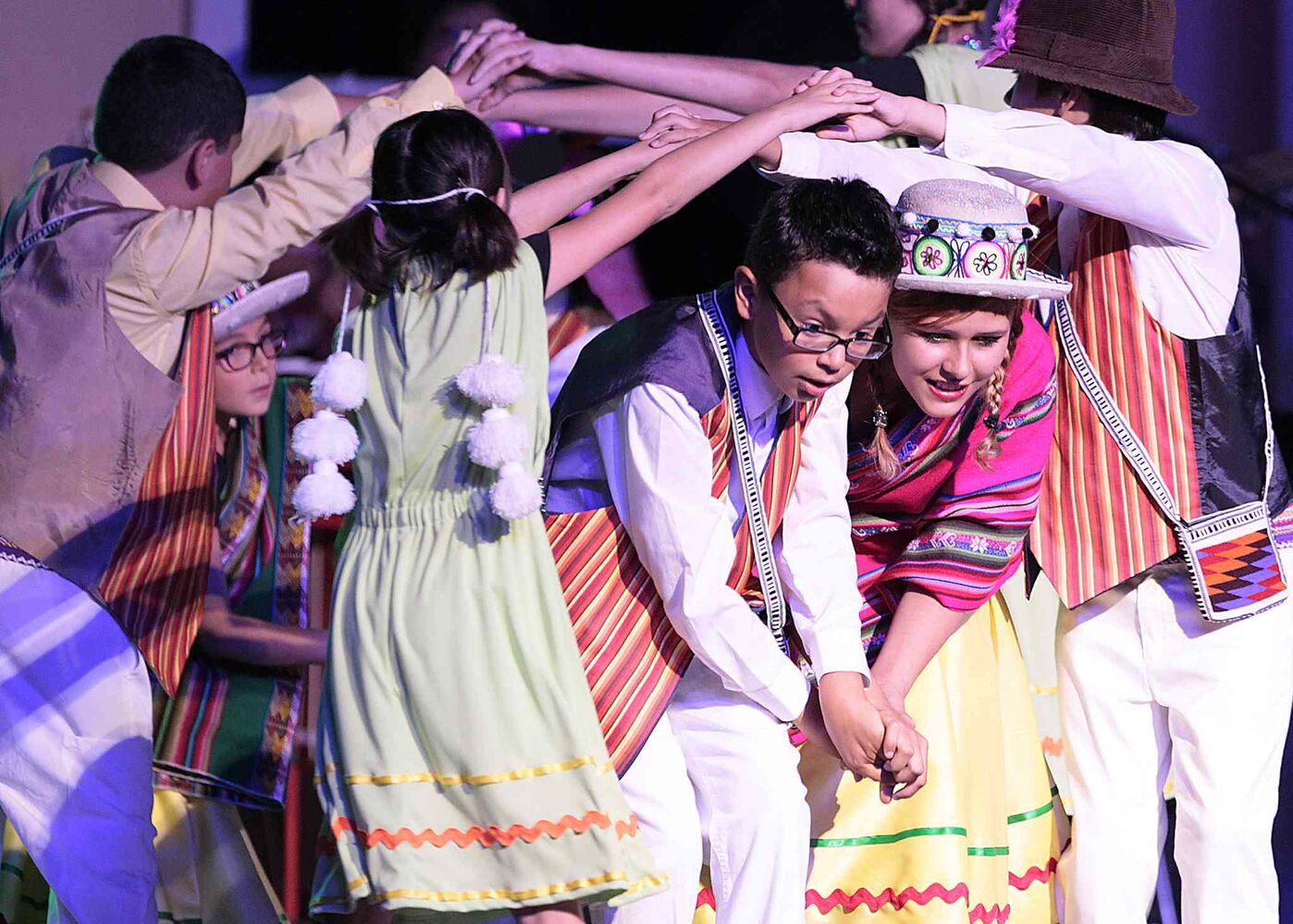 Little ones share their cultural heritage through dance at the Chilean pavilion .