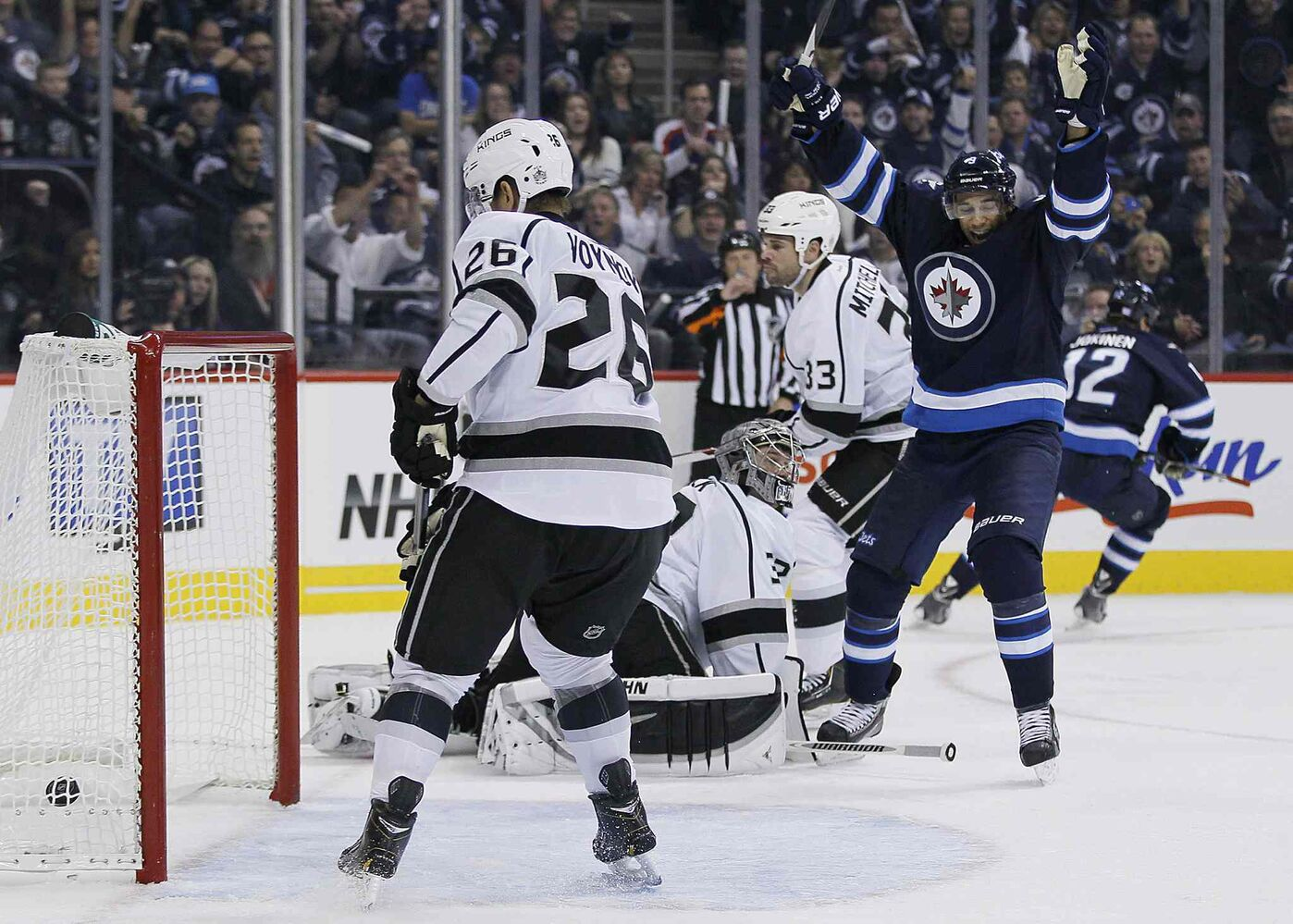 Winnipeg Jets' Evander Kane (9) and Olli Jokinen (12) celebrate Jokinen's goal against the Los Angeles Kings during the second period.