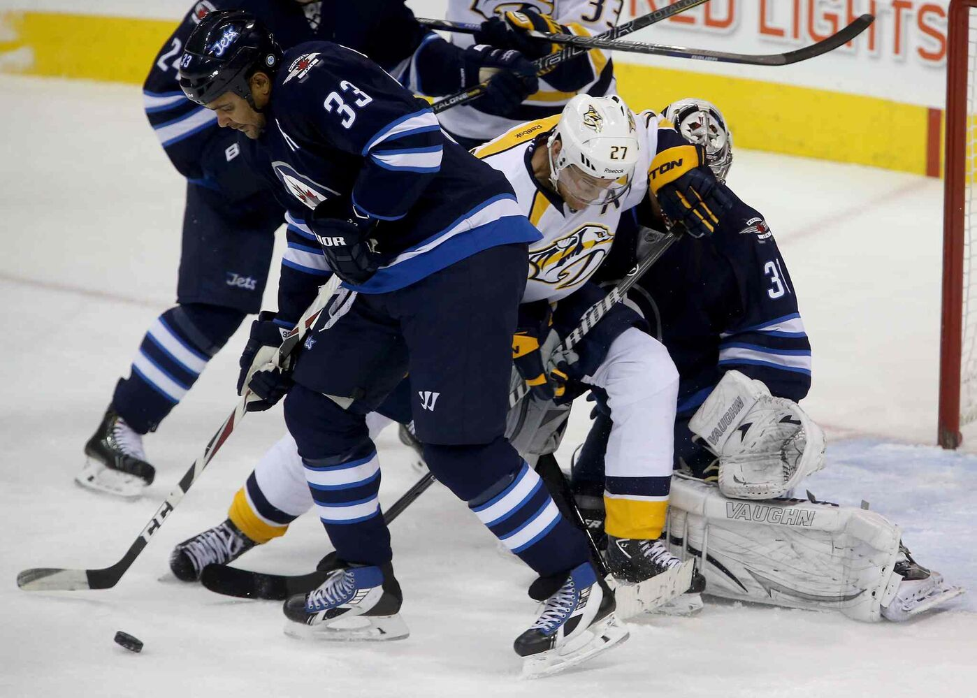 Winnipeg Jets' Dustin Byfuglien blocks a shot as Nashville Predators' Patric Hornqvist (27) screens goaltender Ondrej Pavelec during the first period. (TREVOR HAGAN / THE CANADIAN PRESS)