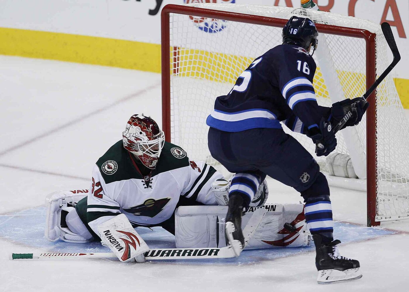 Winnipeg Jets forward Andrew Ladd is stopped by Minnesota Wild goaltender Niklas Backstrom during the shootout. (JOHN WOODS / THE CANADIAN PRESS)