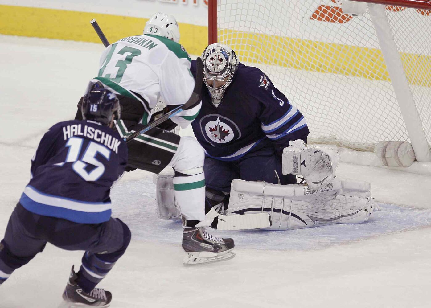 Dallas Stars forward Valeri Nichushkin (top) scores on Winnipeg Jets goaltender Ondrej Pavelec (right) during the first period as Matt Halischuk gives chase. (JOHN WOODS / THE CANADIAN PRESS)