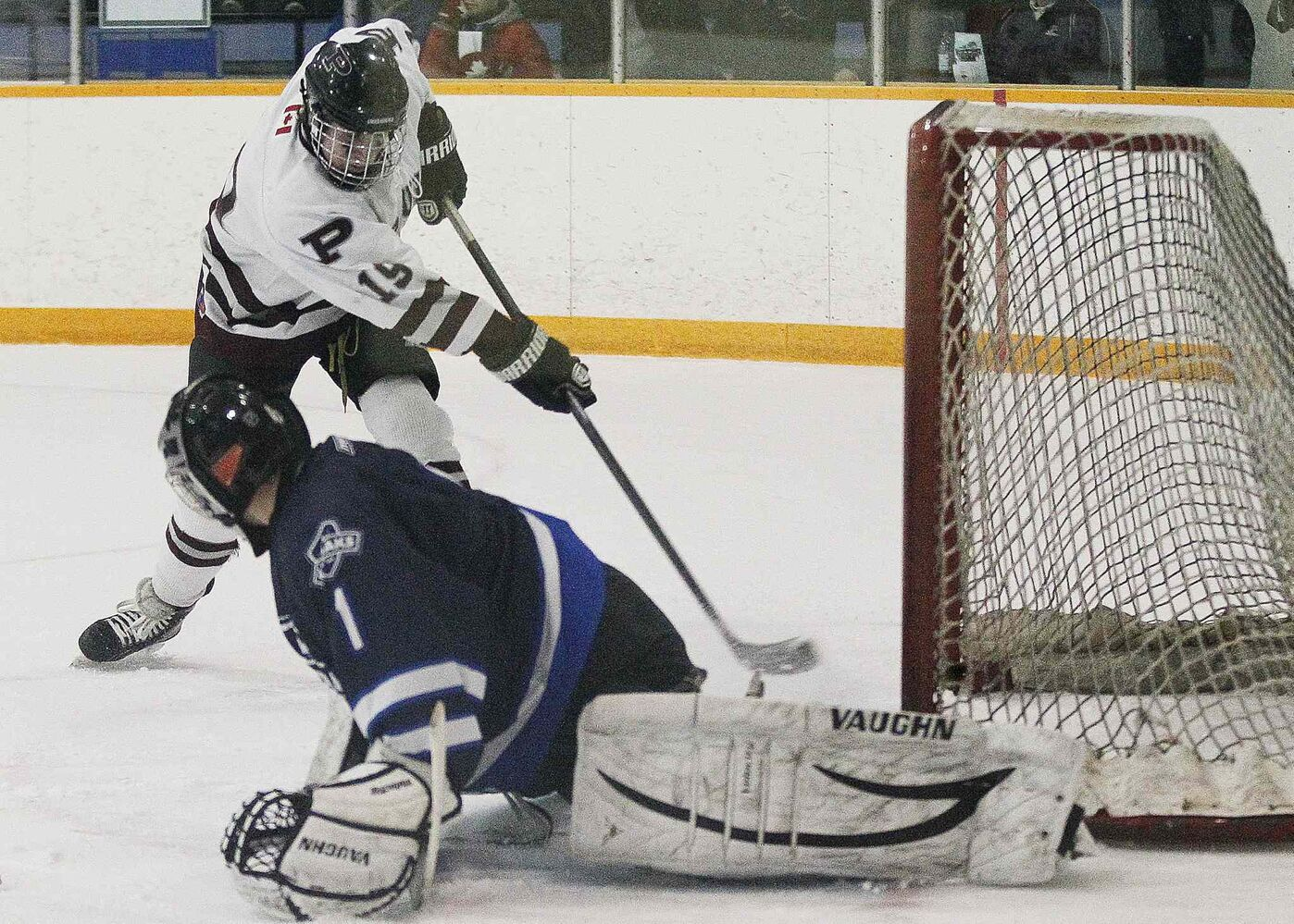 The St. Paul's Crusaders J.P Lovell scores on River East Kodiaks goaltender Myles Piche.