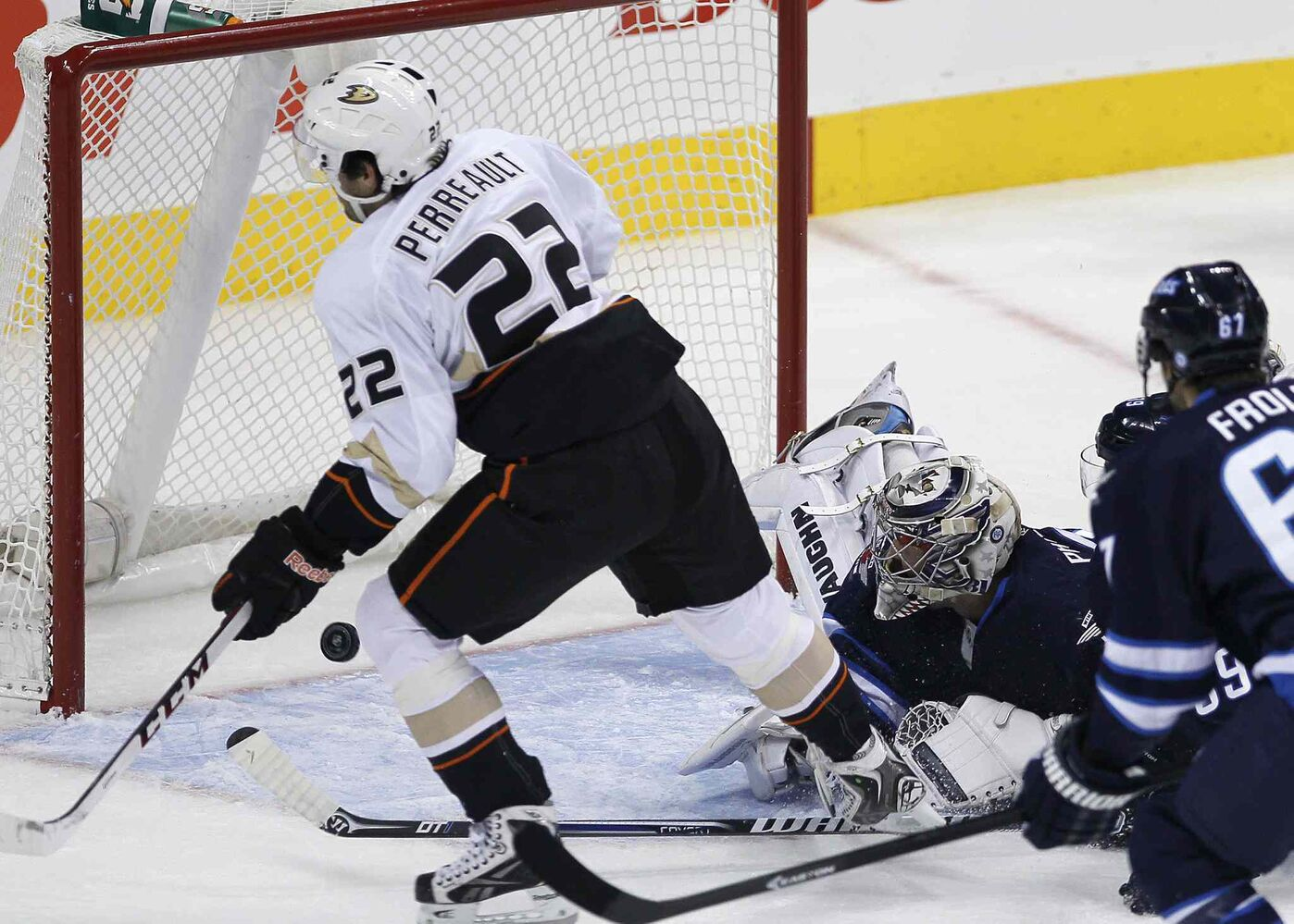 Ondrej Pavelec can't stop the shot from Anaheim Ducks' Mathieu Perreault in the first period.