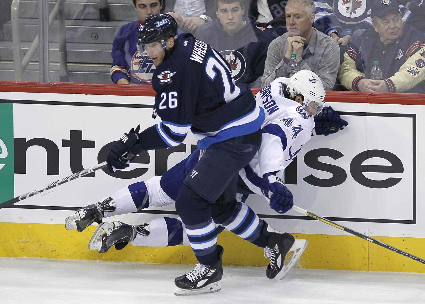 Winnipeg Jets' Blake Wheeler (26) checks Tampa Bay Lightning's Nate Thompson (44) during first period NHL action in Winnipeg Tuesday. (John Woods / Winnipeg Free Press)