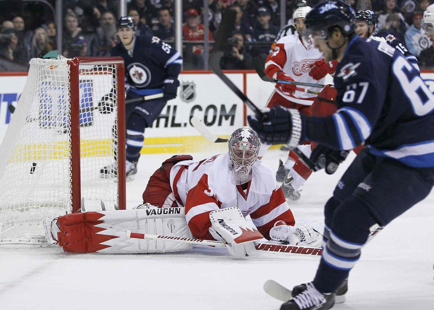 Winnipeg Jets forward Michael Frolik scores on Detroit Red Wings goaltender Jimmy Howard in the second period.