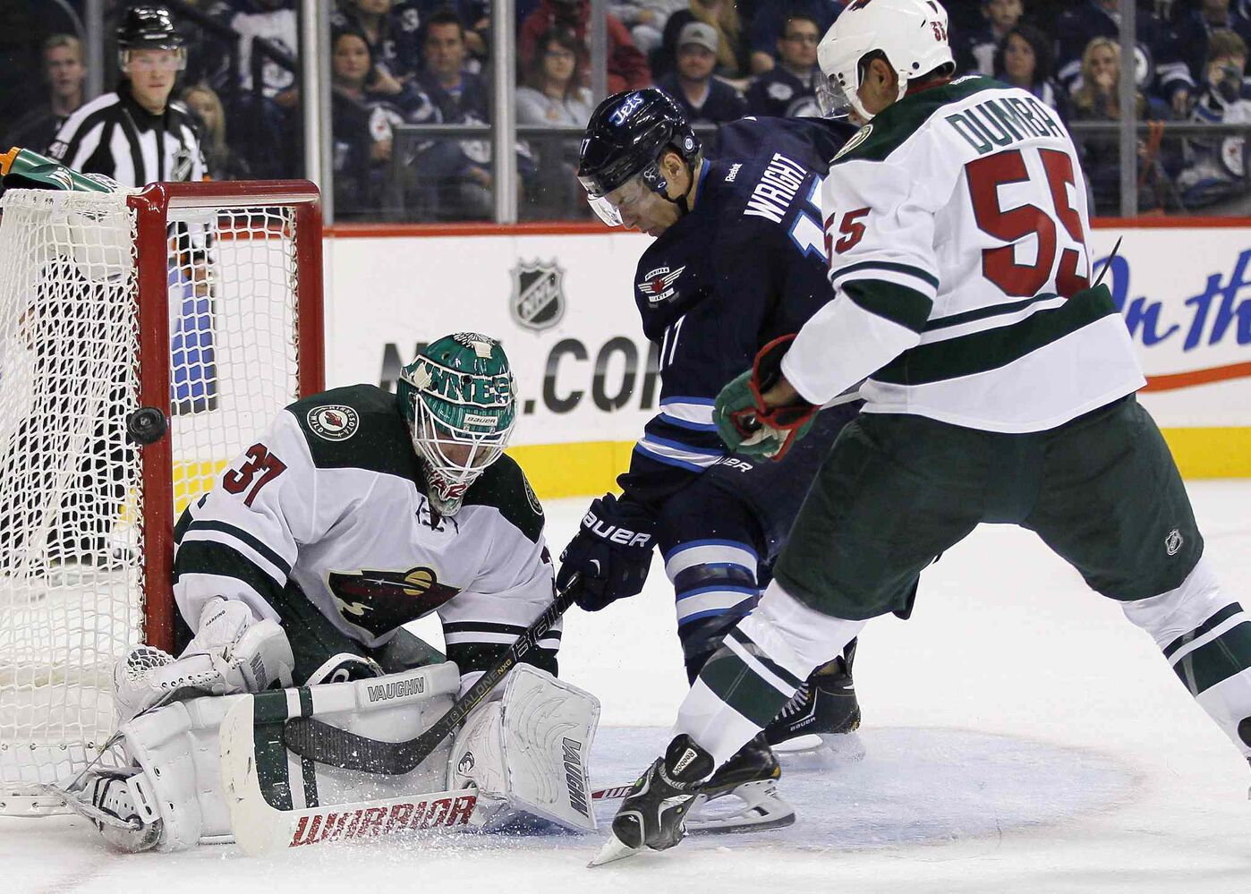 Minnesota Wild goaltender Josh Harding stops James Wright of the Winnipeg Jets during the second period as Mathew Dumba of the Wild tries to move him. (John Woods / The Canadian Press)