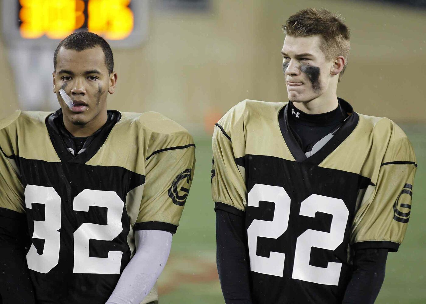 Garden City Gophers Nathan Collings and Keenan Koswin stand dejected after losing to the St.Paul's Crusaders. (Trevor Hagan / Winnipeg Free Press)