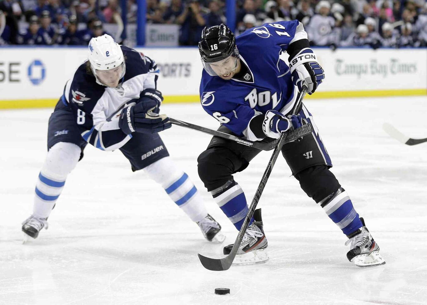 Tampa Bay Lightning winger Teddy Purcell (right) is hooked by Winnipeg Jets defenceman Jacob Trouba during the second period. (Chris O'Meara / The Associated Press)