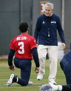 Seattle Seahawks head coach Pete Carroll talks with quarterback Russell Wilson (3) during a team practice for NFL Super Bowl XLIX football game, Thursday, Jan. 29, 2015, in Tempe, Ariz. The Seahawks play the New England Patriots in Super Bowl XLIX on Sunday, Feb. 1, 2015. (AP Photo/Matt York)