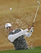 Tigers Woods hits out of the sand trap on the fourth hole during the second round of the Phoenix Open golf tournament, Friday, Jan. 30, 2015, in Scottsdale, Ariz. (AP Photo/Rick Scuteri)