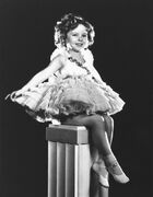 This undated photo shows child actress, Shirley Temple. Costumes, toys, photos and autographs from Temple's 1930s film career are coming to a city near you. A spokeswoman for the late actress said Monday, March 30, 2015, that a collection of keepsakes from Temple's time in Hollywood will be exhibited at museums across the country before being put up for auction in July. (AP Photo, File)