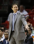 Utah Jazz's head coach Quin Snyder reacts to first half action against the Miami Heat during of an NBA basketball game in Miami, Wednesday, Dec 17, 2014. (AP Photo/Joel Auerbach)
