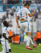 Marseille's French forward Andre-Pierre Gignac, right, celebrates after scoring against Rennes, during their League One soccer match, at the Velodrome Stadium, in Marseille, southern France, Saturday, Sept. 20, 2014. (AP Photo/Claude Paris)