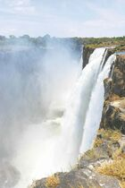 Victoria Falls gorgeous side view viewed from Livingstone Island, Zambia, prior to swimming in Devil's Pool.