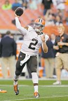 Cleveland Browns quarterback Johnny Manziel (2) warms up before a preseason NFL football game against the St. Louis Rams Saturday, Aug. 23, 2014, in Cleveland. (AP Photo/Tony Dejak)
