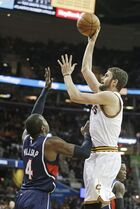 Cleveland Cavaliers' Kevin Love, right, shoots over Atlanta Hawks' Paul Millsap (4) during the first quarter of an NBA basketball game Wednesday, Dec. 17, 2014, in Cleveland. (AP Photo/Mark Duncan)
