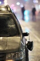 Police investigate after a pedestrian was hit by a car on Corydon Avenue at Wentworth Street Sunday.