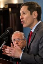 Dr. Thomas Frieden, Director of the Centers for Disease Control and Prevention speaks on the value of annual flu shots as Dr. William Schaffer, from Vanderbilt University School of Medicine, listens during a press conference at the National Press Club in Washington, Thursday, Sept. 18, 2014. Influenza hospitalized a surprisingly high number of young and middle-aged adults last winter, and this time around the government wants more of them vaccinated. (AP Photo/J. David Ake)