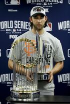 San Francisco Giants starting pitcher Madison Bumgarner holds the MVP trophy after their 3-2 win against the Kansas City Royals in Game 7 of baseball's World Series Wednesday, Oct. 29, 2014, in Kansas City, Mo. (AP Photo/Charlie Neibergall)