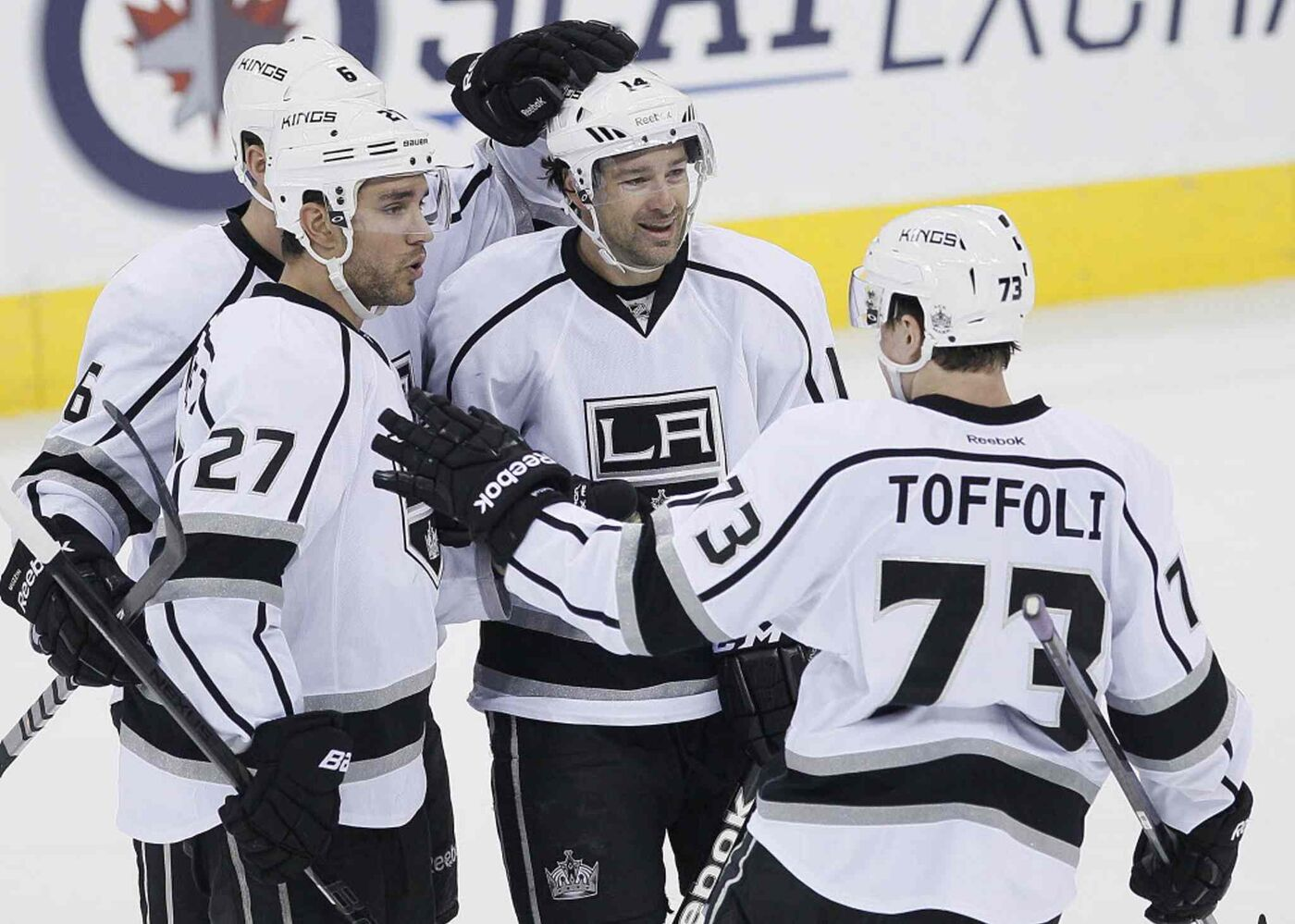 Los Angeles Kings' Jake Muzzin (6), Alec Martinez (27), Justin Williams (14) and Tyler Toffoli (73) celebrate Martinez's goal against the Winnipeg Jets during third period NHL action.