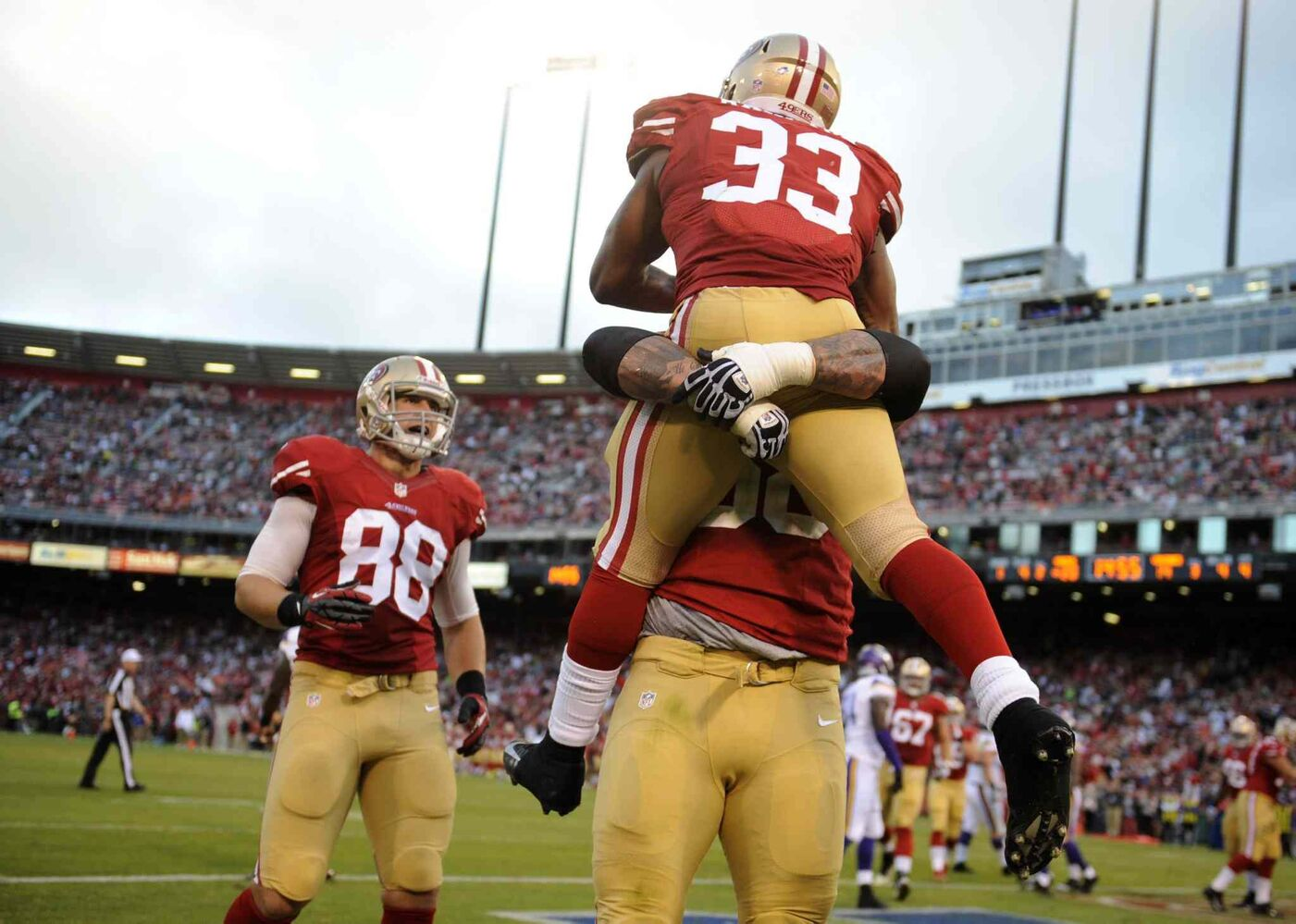 San Francisco 49ers' Jewel Hampton (33) celebrates his fourth-quarter touchdown against the Minnesota Vikings during a preseason game at Candlestick Park in August 2013.