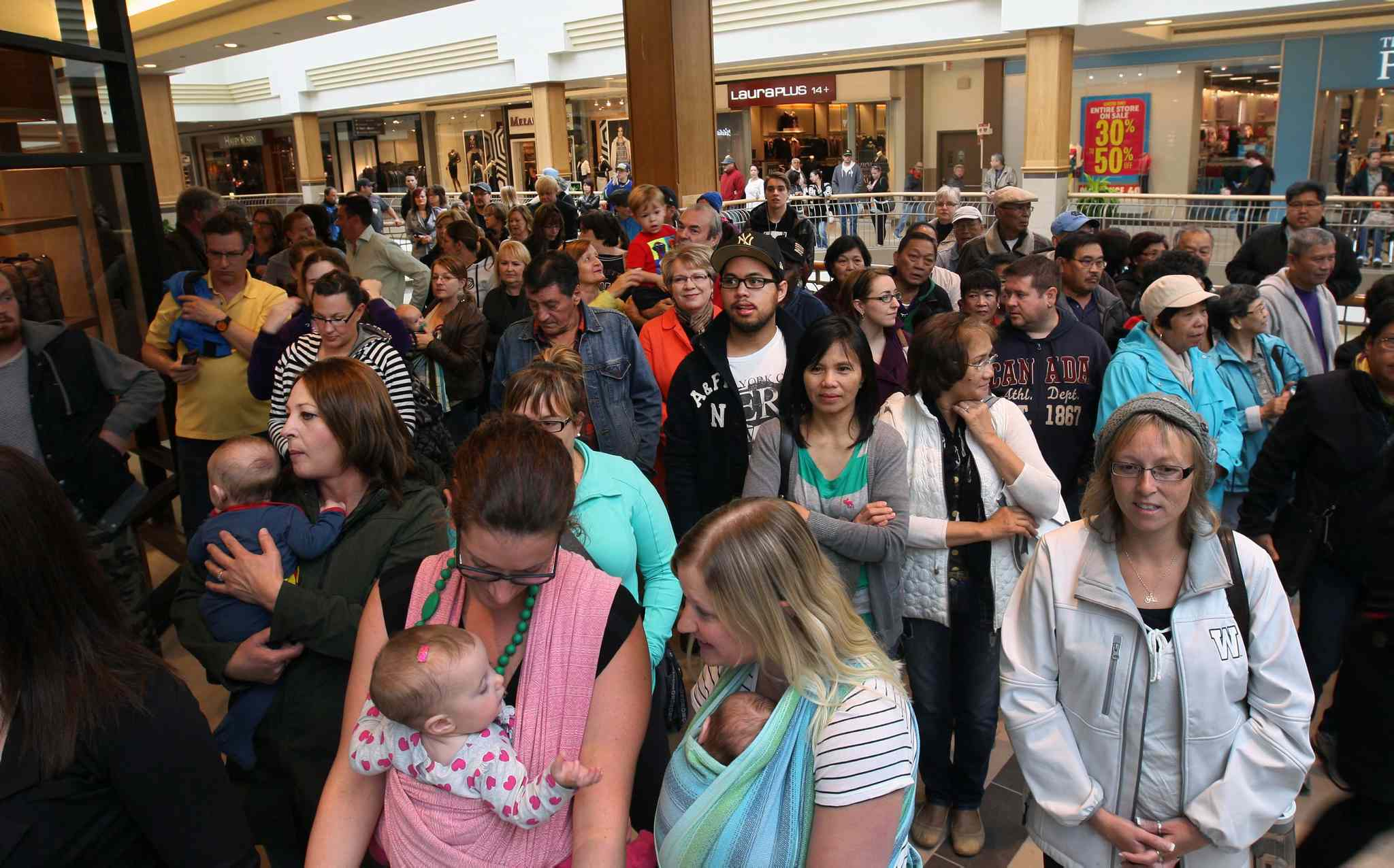 Crowds line up to check out the newly opened stores.