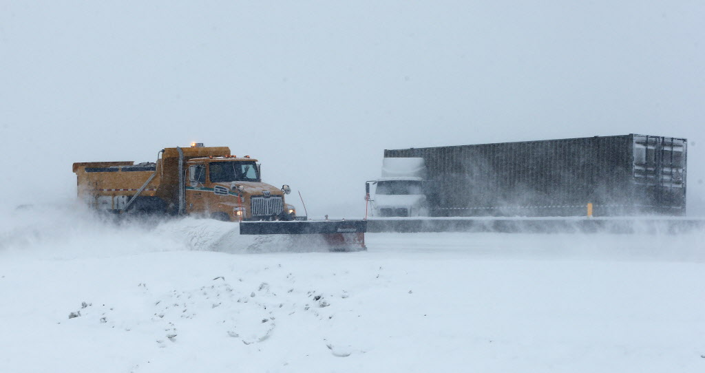 Snow plows hit the streets amid steady snow Friday that made driving outside the city nearly impossible — as shown by this jack-knifed semi on the North Perimeter east of Henderson Highway.