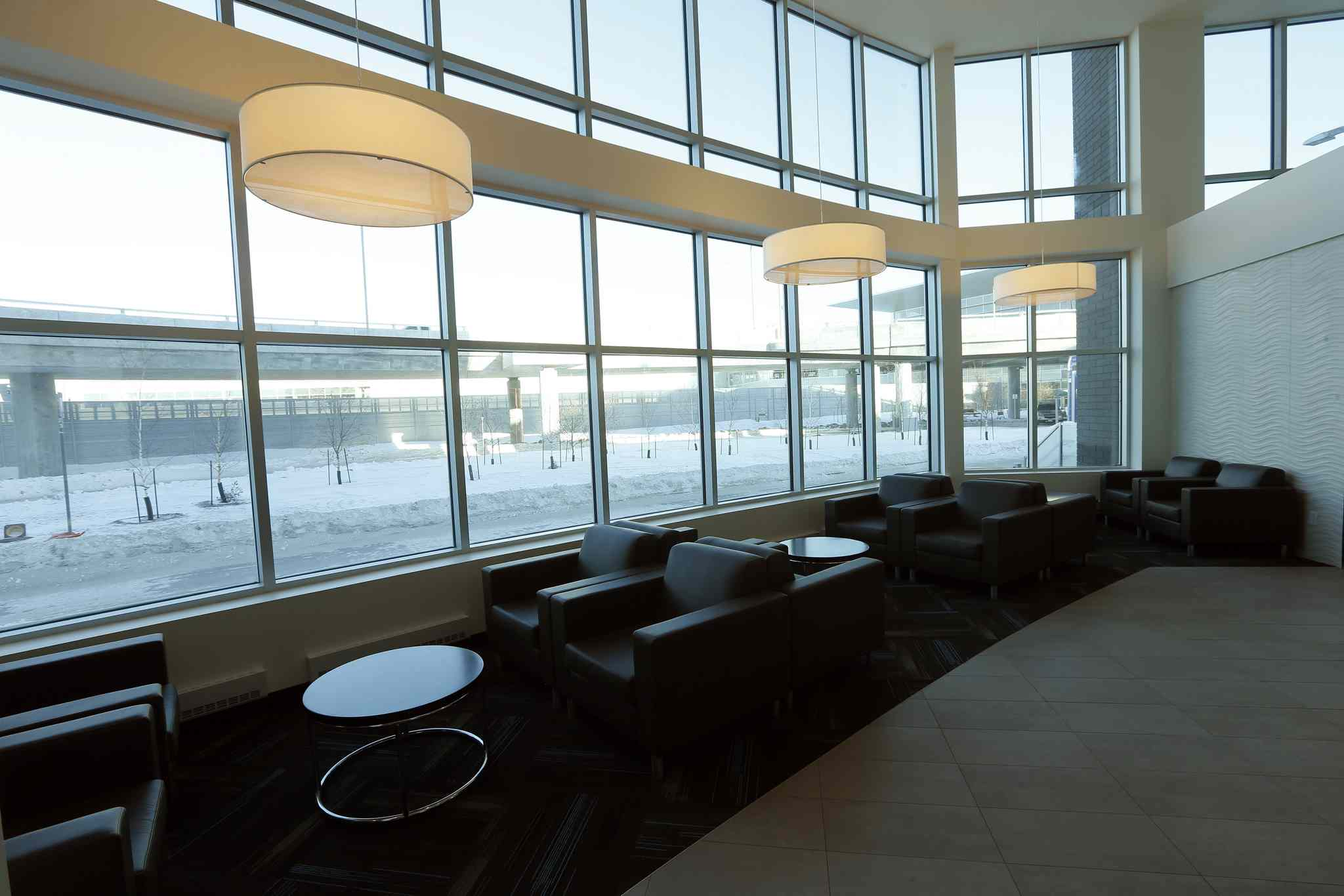 Seating in the lobby shows a view of the airport.