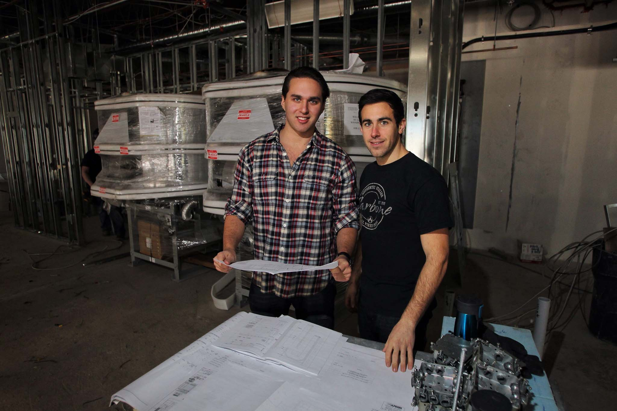 "Carbone, a new pizza restaurant/lounge that's coming to downtown Winnipeg, will add a new twist to the phrase ""beer on tap"": It will have the province's first self-pour beer system.  Benjamin Nasberg (left) and Joseph Paletta plan to open the pizza place's downtown location on St. Mary Avenue in March."