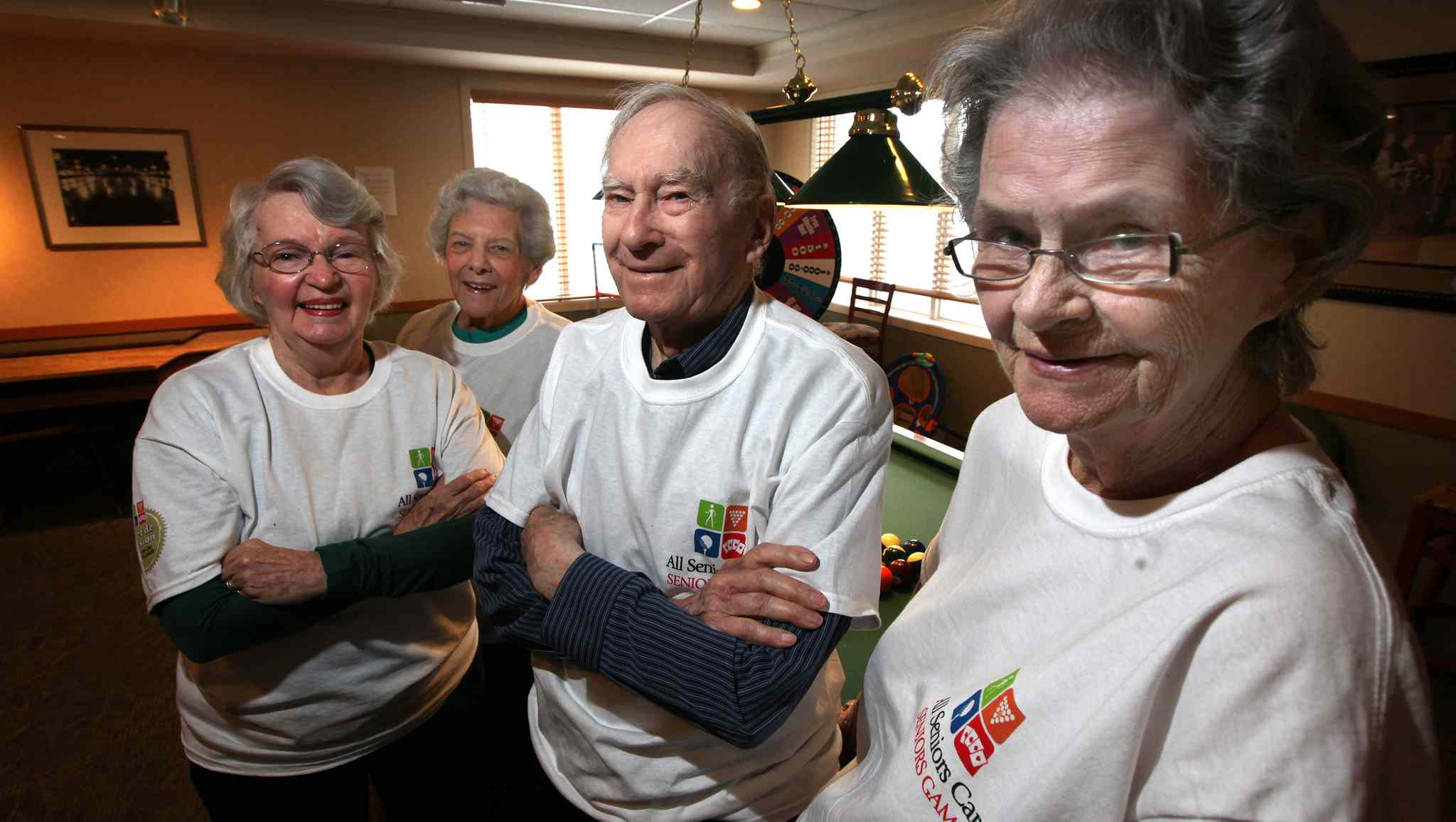 From left,  Peggy Stewart,  Alice Brown, husband Lloyd Brown and  Pat Baker at the  Sturgeon Creek  Retirement Residence. They're amped for Canada's All Seniors Care Living Centres Games.