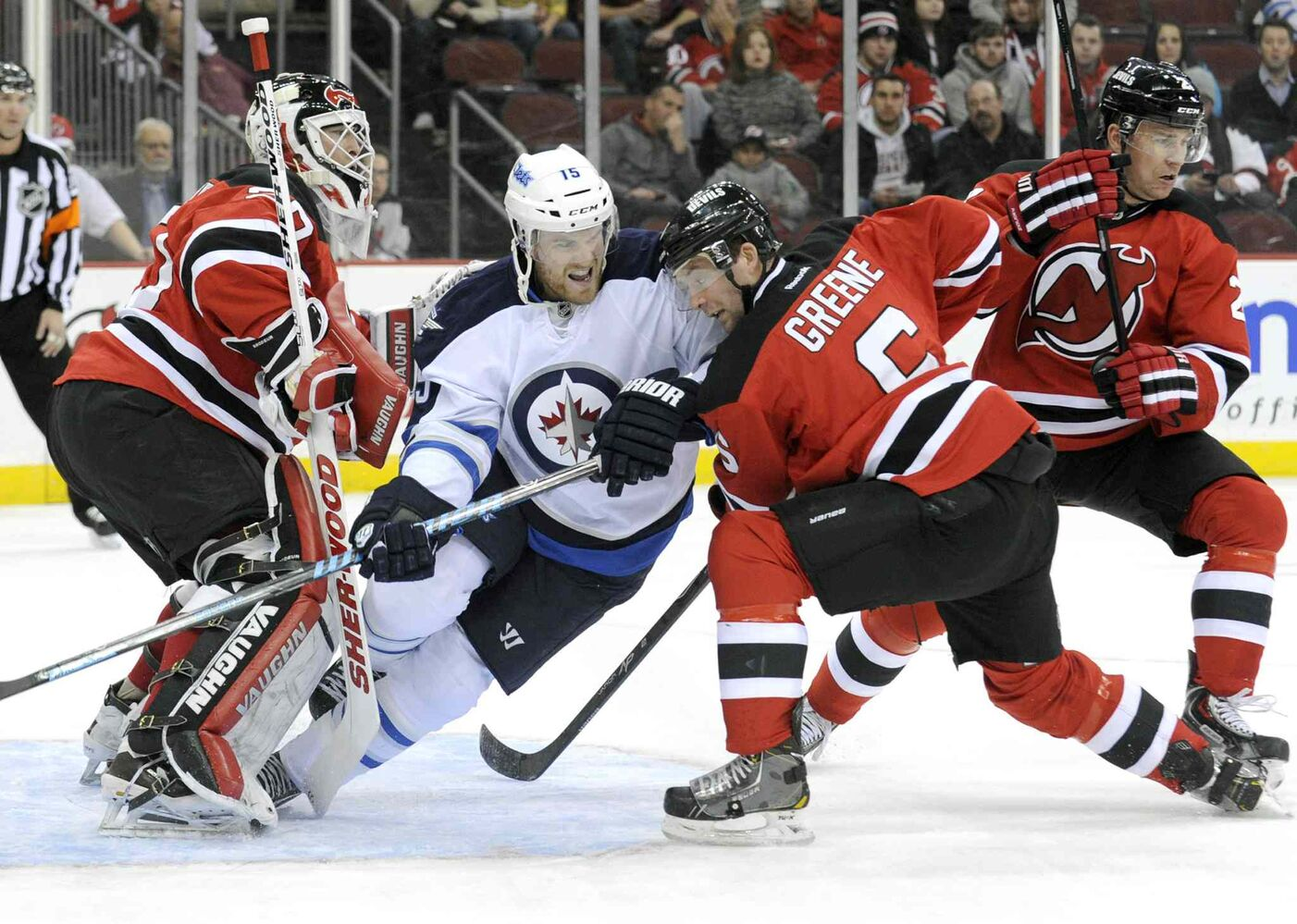 New Jersey Devils' Andy Greene (6) checks Winnipeg Jets' Matt Halischuk into Devils goaltender Martin Brodeur during the first period. (BILL KOSTROUN / THE ASSOCIATED PRESS)