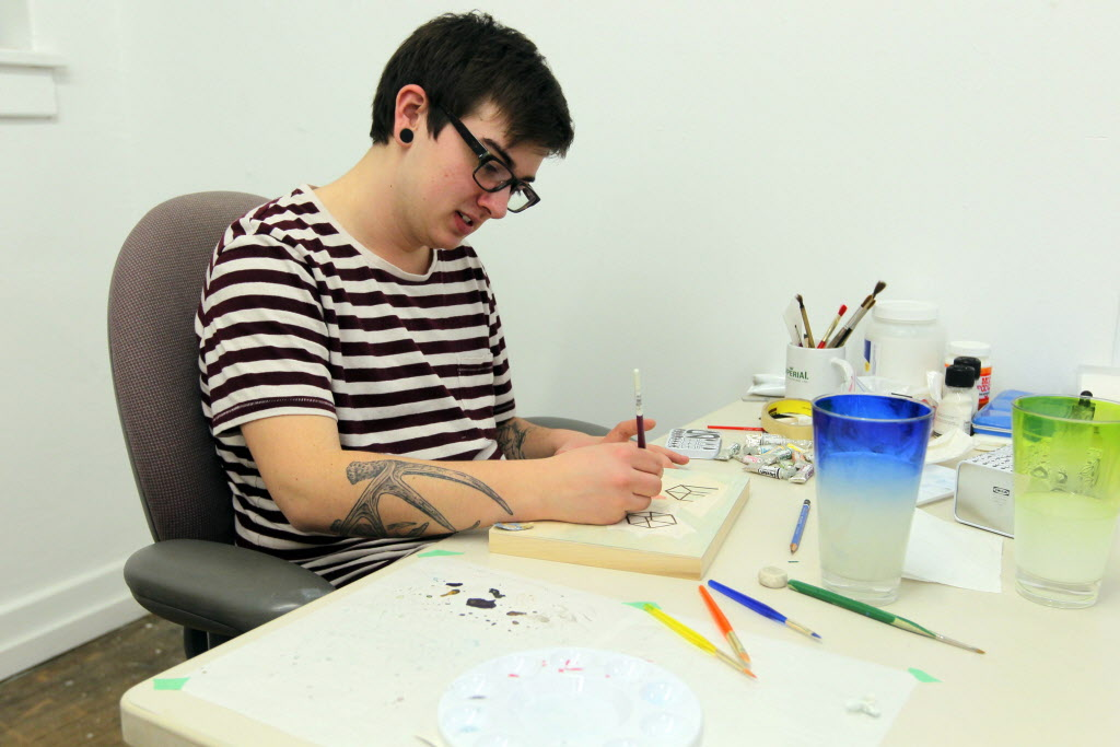 Julian Kirchmann is one of the artists participating in a 24-hour art-a-thon, which kicked off Thursday at 5 p.m. Artwork produced during the event will be auctioned off to benefit Artbeat Studio. (Boris Minkevich / Winnipeg Free Press)